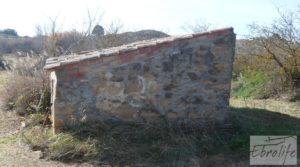 Finca en la huerta de Caspe con masía de piedra. en venta con olivos