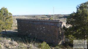 Foto de Finca en la huerta de Caspe con masía de piedra. con olivos por 19.000€