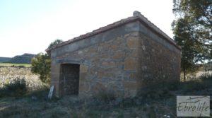 Se vende Finca en la huerta de Caspe con masía de piedra. con acceso asfaltado por 19.000€