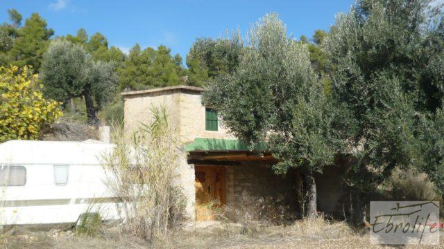 Casa en el río Tastavins, en La Portellada.